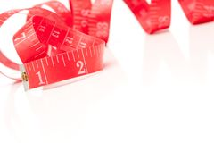 Red Measuring Tape on White Stock Image