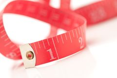 Red Measuring Tape on White Royalty Free Stock Photography