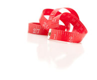 Red Measuring Tape on White Royalty Free Stock Photo