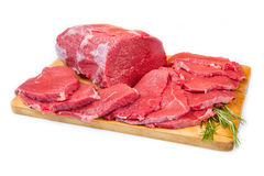 Red meat chunk and steak isolated over wood background stock photos