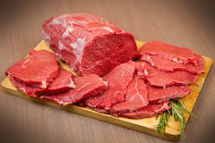 Red meat chunk and steak isolated over wood background Royalty Free Stock Image