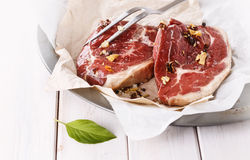 Red meat with fork over white background Stock Photos