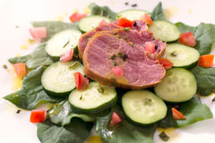 Red meat. Fresh baked red meat on the top of vegetables Stock Images