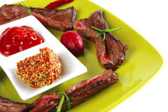 Red meat on green plate Stock Photo
