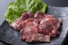 Red meat Haramisuji of cattle with lettuce on black dish Stock Images