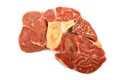 Red meat. A large piece of red meat with a bone on a white background Royalty Free Stock Images