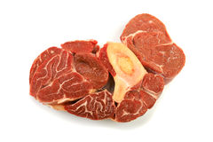 Red meat. A large piece of red meat with a bone on a white background Stock Images