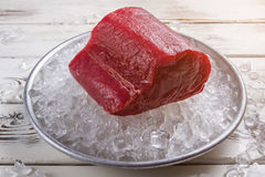 Red meat lying on ice.