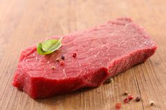 Red meat and pepper. On wood royalty free stock photo