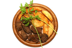 Red meat and potato. Red grilled meat with potato on plate Stock Photography