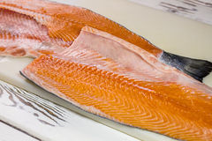 Red meat of raw fish. Fish meat on cooking board. Fillet of salmon for sushi. Seafood high in nutrients Royalty Free Stock Image