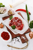 Red meat and species over white background Stock Photography