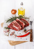 Red meat and spices over white background Stock Photo