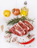 Red meat, vegetables and spices over white background Stock Photos
