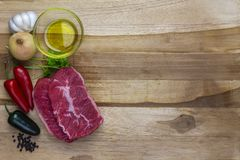 Red meat on a wooden platter royalty free stock photography