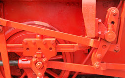 Red mechanics. Driving wheel of an old steam train Stock Photo