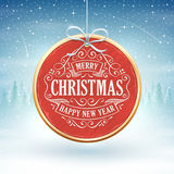Red Medallion with Christmas Greeting in the Foreground  Stock Photography