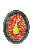 Red medical rose hips fruits and one pear in oval frame Royalty Free Stock Photos