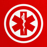 Red Medical Symbol. Red Health Care Caduceus Symbol in Circle Stock Photography