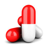 Red Medicine Pill Capsules On White Background Stock Photography