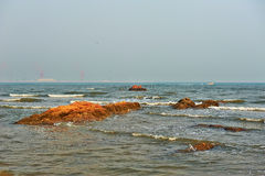 The red megalith in sea Royalty Free Stock Image