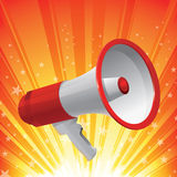 Red Megaphone. With star burst as background. Communication concept Royalty Free Stock Photography