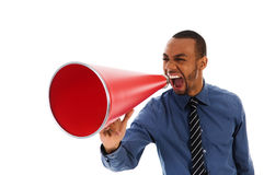 Red Megaphone. African-american business man yelling in a red megaphone Royalty Free Stock Image
