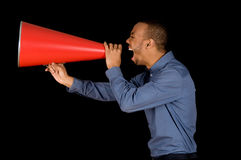Red Megaphone. African-american business man yelling in a red megaphone Royalty Free Stock Photos