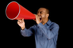 Red Megaphone. African-american business man yelling in a red megaphone Stock Image