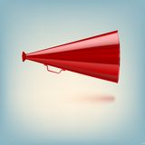 Red megaphone on colored background Stock Photography