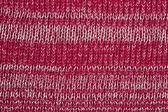 Red melange striped stockinet as background Stock Images