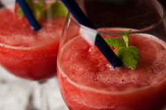 Red melon slushy drink. A refreshing red melon slushy drink in glasses. Whole series with sebczseries950 keyword Stock Photos