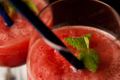 Red melon slushy drink. A refreshing red melon slushy drink in glasses. Whole series with sebczseries950 keyword Royalty Free Stock Image