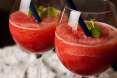 Red melon slushy drink. A refreshing red melon slushy drink in glasses. Whole series with sebczseries950 keyword Stock Photography
