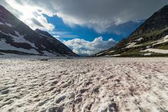Red melting snow at high altitude in the Alps Royalty Free Stock Photos