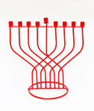Red Menorah on a white background. Hanukkah. Holiday Royalty Free Stock Photo