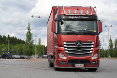 Red Mercedes-Benz Actros Leaves Truck Stop Royalty Free Stock Image