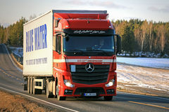 Red Mercedes-Benz Actros Semi Trailer on the Road Stock Photography