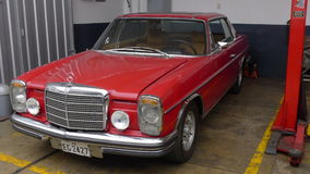 Red Mercedes-Benz 280C coupe in Miraflores, Lima Royalty Free Stock Photo