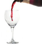 Red Merlot Wine Pouring into a Chilled Glass Royalty Free Stock Photos