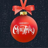 Red Merry Christmas ball with ribbon and a bow, hand drawn lettering. Isolated on black background. Stock Photos