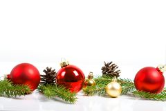 Red merry christmas ornaments and xmas tree on white Royalty Free Stock Photo