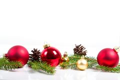 Red merry christmas ornaments and xmas tree on white Stock Photo