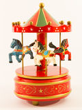 Red merry-go-round horse carillon. Wooden carouse Royalty Free Stock Photos