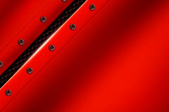 Red metal background with rivet on gray metallic mesh. Royalty Free Stock Photos