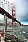 Red Metal Bridge on White Under White Clouds during Daytime Stock Photography