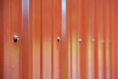 Red Metal Building Siding. Shiny metal red siding on the side of a building on a farm Royalty Free Stock Photos