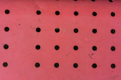 Red metal construction with holes dotted top view looking down abstract view design retro pattern. Red metal construction with holes dotted top view looking down stock photos