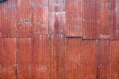 Red metal corrugated siding with rust Royalty Free Stock Photo