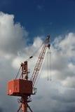 Red metal crane Stock Photos